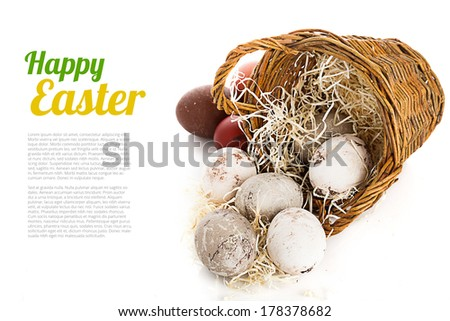 Easter eggs in wattled basket isolated on white background - stock photo