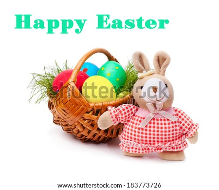 Easter eggs in wicker with teddy rabbit on white background - stock photo