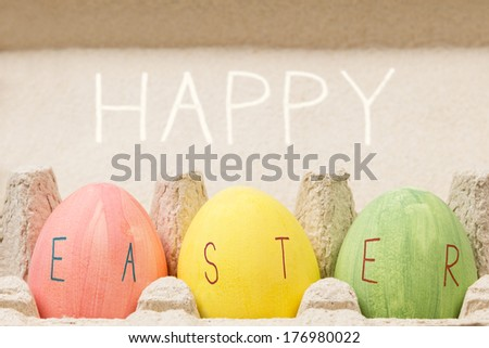 easter eggs inside container, rustic style - stock photo