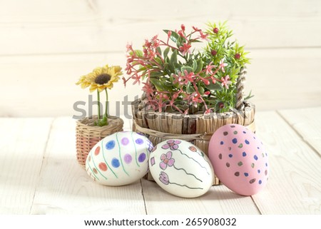 Easter eggs lying on the wood - stock photo