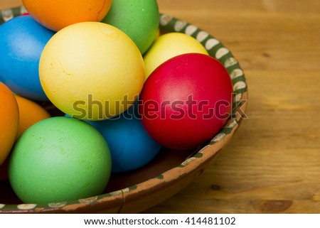 Easter eggs of different colors on a wooden background