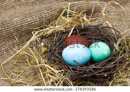 Easter eggs on a wooden table .