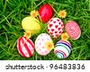 Easter Eggs  on Fresh Green Grass - stock photo