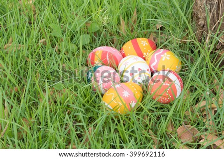 easter eggs on grass near tree