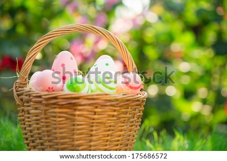 Easter eggs on green grass. Shallow depth of field - stock photo