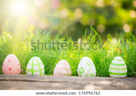 Easter eggs on green grass. Spring holidays concept - stock photo