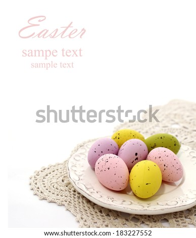 easter eggs on old plate isolated on white background - stock photo