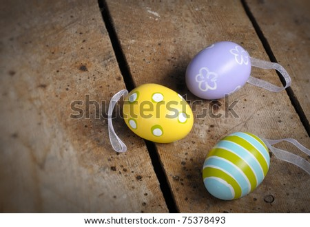 Easter eggs on old vintage table top with copy space - stock photo