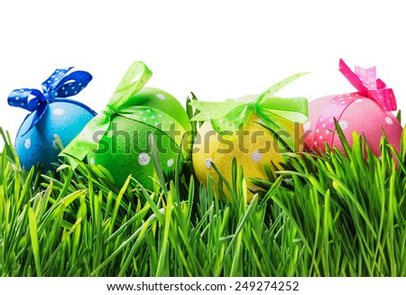 Easter eggs on the grass isolated on white background - stock photo