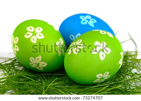 Easter eggs on the grass over white background