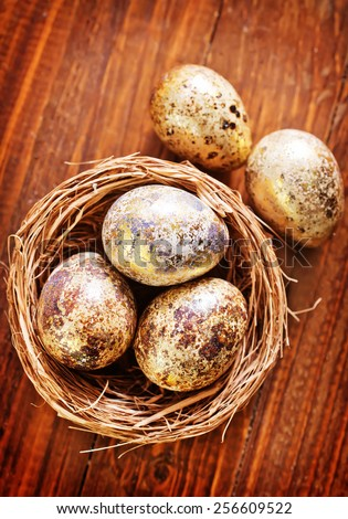 easter eggs on the wooden table, color eggs - stock photo
