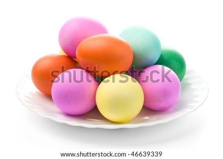 Easter eggs on white plate. Close-up. Isolated on white