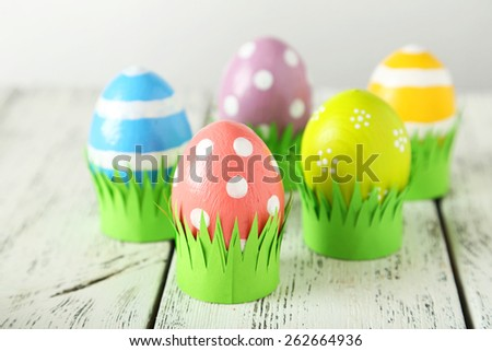 Easter eggs on white wooden background - stock photo