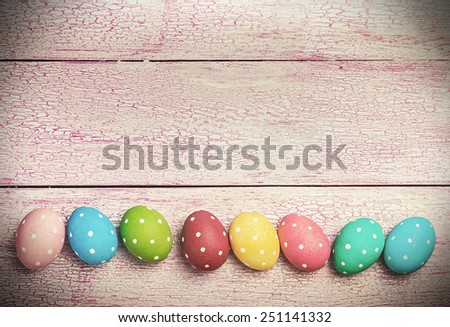 Easter eggs on wooden background. Focus on eggs. toning image   - stock photo