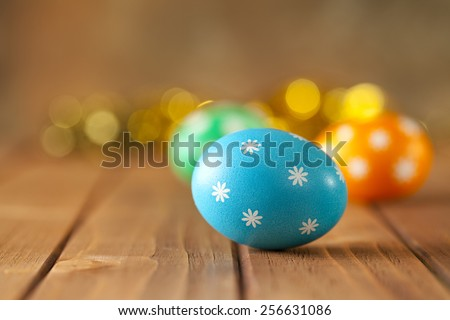 Easter eggs on wooden boards - stock photo