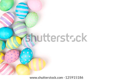 Easter eggs painted in pastel colors on a white background - stock photo