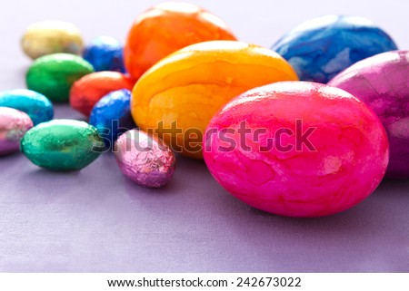 Easter Eggs painted in vivid colors and two sizes, copyspace