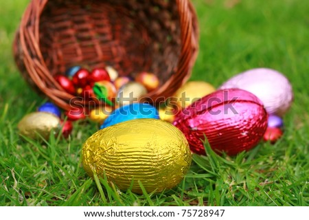 Easter Eggs  with Basket on the Grass - stock photo