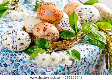 Easter eggs with blossom on the table - stock photo