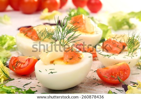 Easter eggs with mayonnaise and salmon  - stock photo