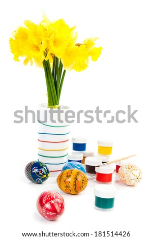 Easter eggs with paints and flowers - stock photo