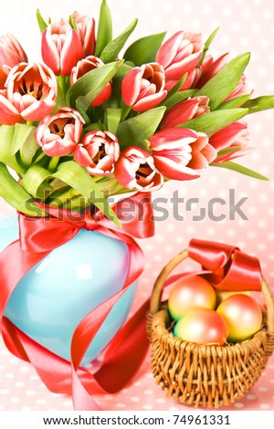 easter eggs with pink tulips bouquet