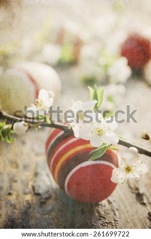 Easter eggs with spring blossom. Texture added. - stock photo