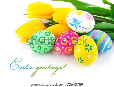 easter eggs with yellow tulip flowers isolated on white background - stock photo