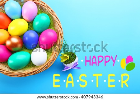 Easter greeting card. Colorful eggs in basket on blue background - stock photo