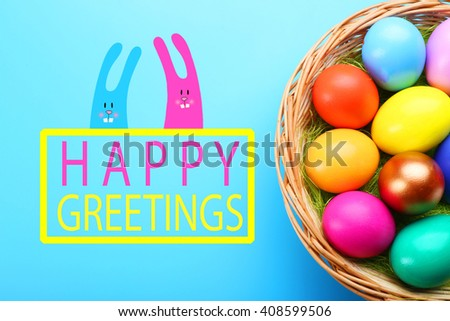 Easter greeting card. Colorful eggs in nest on blue background - stock photo