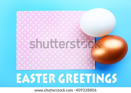Easter greeting card. Two eggs on blue background - stock photo