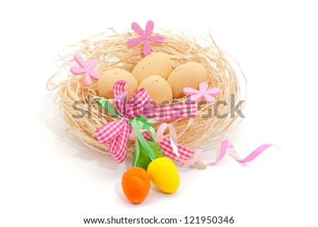 Easter greeting card with eggs in the nest