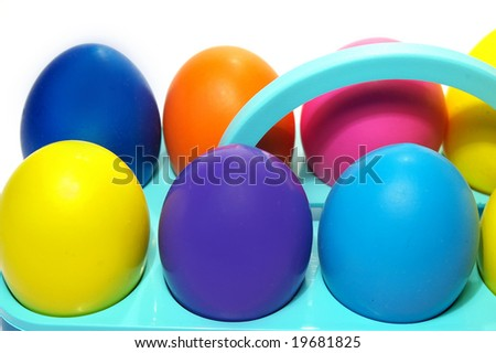Easter holiday. Color eggs in a tray on white  background.