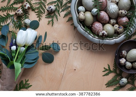 Easter holiday composition with pastel eggs painted with natural dyes, top view - stock photo