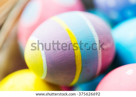 easter, holidays, tradition and object concept - close up of colored easter eggs - stock photo