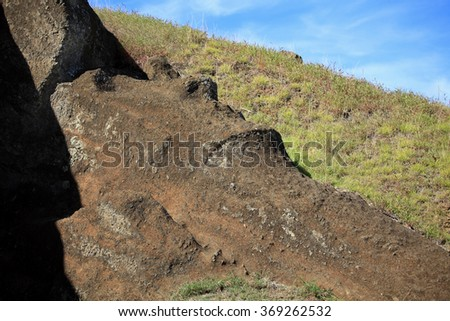 Easter Island Moais, in the Quarry area.  Some Moais are not erect, and incomplete. - stock photo