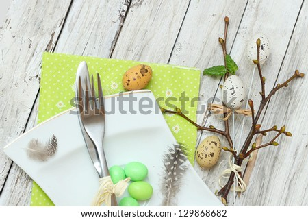 Easter menu. Knife with fork and Easter egg - stock photo