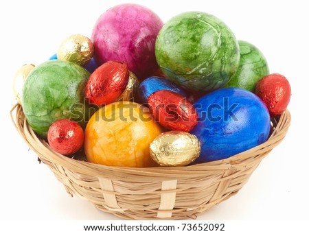 easter nest with eggs an chocolate - stock photo