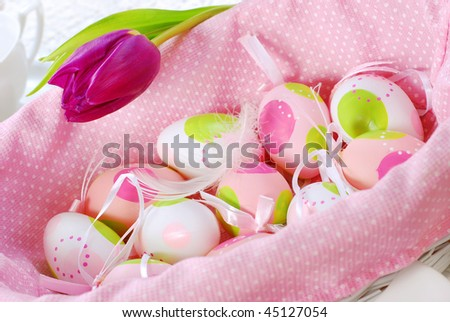 easter painted eggs in pink basket