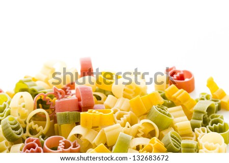 Easter pasta in yellow, red and green colors.
