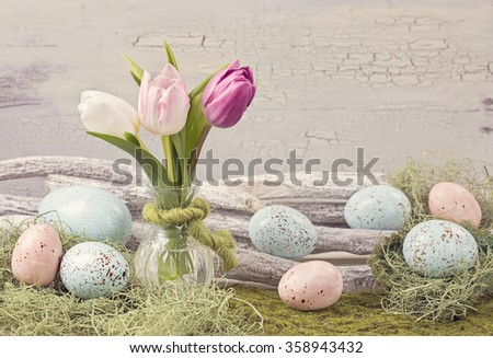 Easter pastel colored decoration on grass - stock photo