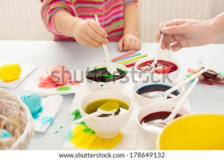 easter preparation with colorful dyes and egss - stock photo