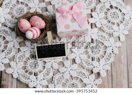 Easter present. Easter chalkboard. Easter eggs. easter nest. Easter nest on the lace. easter lace.  - stock photo