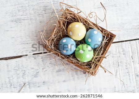 easter quail egg decoration on wooden background - stock photo