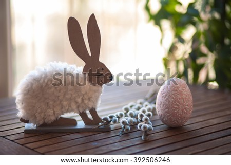Easter rabbit and egg on wood table