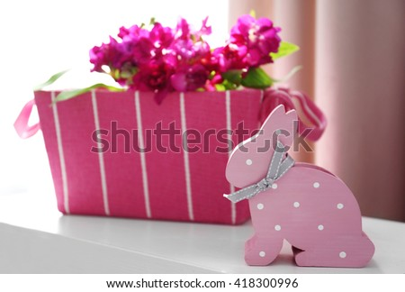 Easter rabbit and flowers on the table