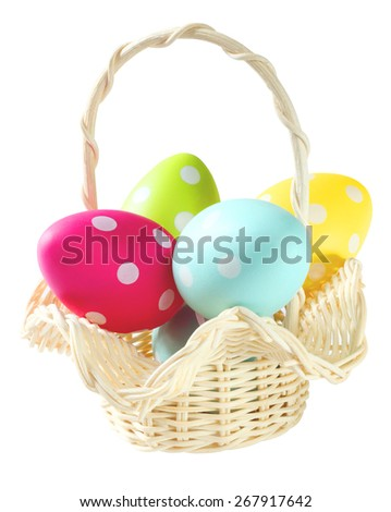 Easter's eggs in basket isolated white background. - stock photo