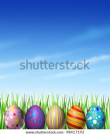 Easter spring decoration with decorated traditionally painted eggs as a cultural and religious celebration of renewal and hope  as an egg hunt game for kids with grass and a blue sky design element. - stock photo