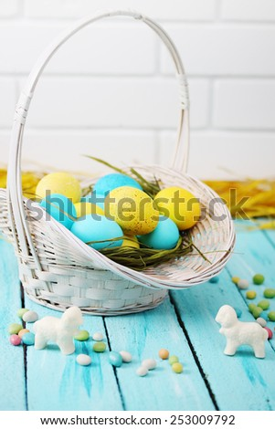 Easter still life basket of colored eggs - stock photo