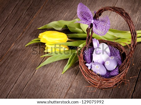 Easter still life with eggs in basket - stock photo